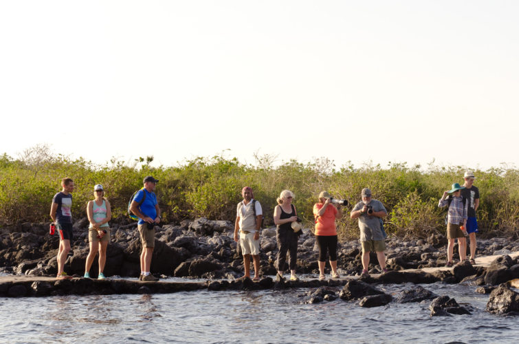 Tourists enjoying the heat of the Galapagos Islands